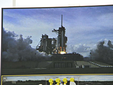 The shuttle can be seen on the pad on a large screen