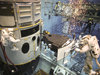SM4 EVA Astronauts practice installing Hubble's new panchromatic imaging instrument, the Wide Field Camera 3, during final underwater training.