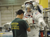 HST SM4 EVA astronaut Mike Massimino prepares to enter the water at the NBL