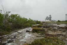 A debris-covered road with erosion near Launch Pad 39A at NASA's Kennedy Space Center in Florida.