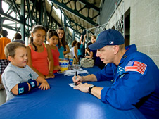 Astronaut Clay Anderson autographing