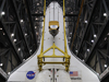 Suspended above the transfer aisle in the Vehicle Assembly Building,  Atlantis is ready to be lifted into high bay 3