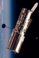 Image of the Hubble floating in space, oriented vertically