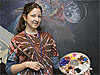 Amanda Chichoracki stands in front of a space-themed mural