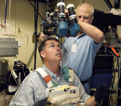 STS-126 Mission Specialist Shane Kimbrough and JSC technician.