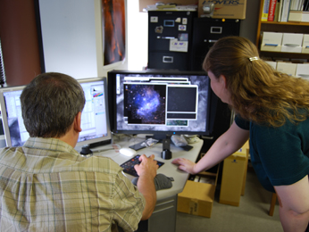Zolt Levay (left), senior image processor, and Vanessa Thomas, informal science specialist, review data retrieved from the Hubble Space Telescope archive