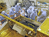 EVA crewmembers and HST engineers inspect the Cosmic Origins Spectrograph