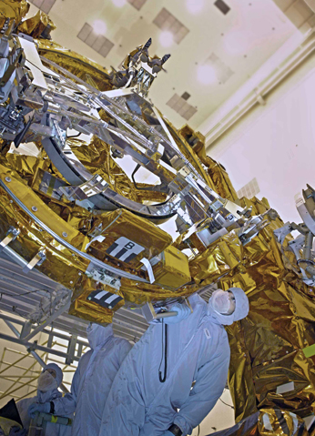 EVA crewmembers and HST engineers inspect the Soft Capture Mechanism (SCM)