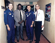 Camera designer - NASA contractor Shelby Jacobs flanked by STS-26 astronauts Dick Covey and David Hilmers. To the right is Carl Anderson, Jacobs' co-worker at Rockwell International. Photo credit-Shelby Jacobs