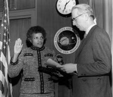 Ready for duty - Dr. Harriett Jenkins being sworn in by NASA Administrator James Fletcher in 1974 as the agency's assistant administrator for Equal Opportunity Programs.