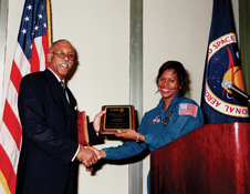Recognizing African-American achievements - Julian Earls, with astronaut Joan Higginbotham, keynoted the Kennedy Space Center's 2000 African-American History Month celebration.