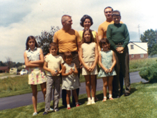 Glory days - The Kranz family during the Apollo program years. Pictured front row from left to right are Carmen, Mark, Jeannie, Lucy, Brigid, and cousin John Kittle; back row, Gene, Marta and cousin Joe Kittle. Photo credit-Courtesy of Jeannie Kranz