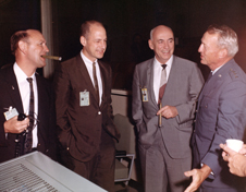 Splashdown cigars - Manned Space Flight Center Deputy Director George M. Low joins colleagues in celebrating the successful conclusion of the Gemini IX-A spaceflight on June 6, 1966. Pictured are left to right, Christopher Kraft, director of Flight Operations; Low, Dr. Robert Gilruth, Manned Space Flight Center director, and Lt. Gen. Leighton Davis, DoD manager of Manned Space Flight. Photo credit-Department of Defense