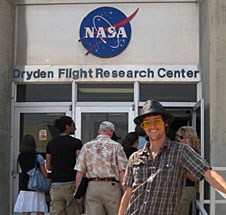 Borden stands in front of an entrance marked Dryden Flight Research Center