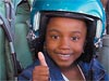 Girl with flight helmet on giving a thumbs up