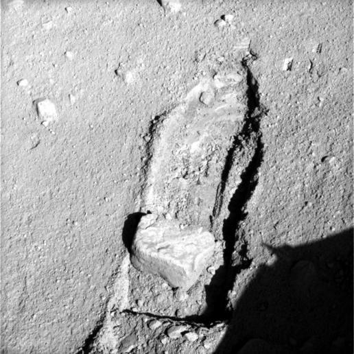 Rock Moved by Mars Lander Arm