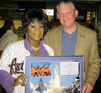 Patti LaBelle and JSC Center Director Jefferson D. Howell Jr. honor the Columbia crew at the opening day of the Houston Astros.