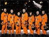 The STS-125 crew in orange launch and entry suits
