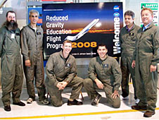 Teachers and mentors wearing green flight suits