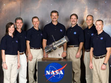 The crew of STS-125 with a model of the Hubble Space Telescope