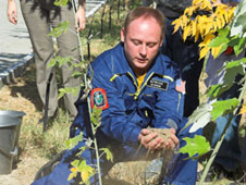 Michael Fincke conducts traditional planting of tree