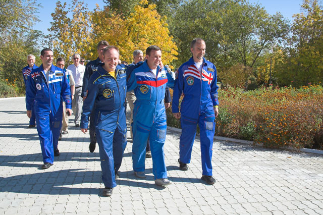 Crew strolls outside the Cosmonaut Hotel crew quarters