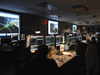 Engineers look on in the Space Telescope Operations Control Center as commands are sent to the SIC and DH.