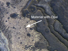 Martian rocks containing a hydrated mineral similar to opal
