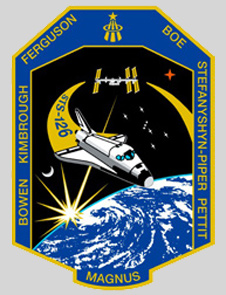 The STS-126 patch shows the shuttle, the space station, Earth, the moon, stars, Mars and the names of the astronauts