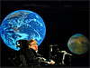 Professor Stephen Hawking in front of a picture of Earth and Mars