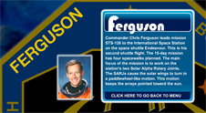 A close-up view of the name Ferguson on the STS-126 mission patch and a photo of  Chris Ferguson