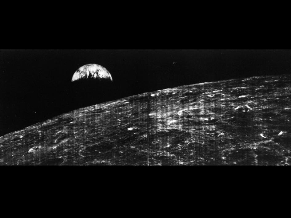 The world's first view of Earth taken by a spacecraft from the vicinity of the Moon.