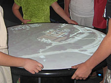 Visitors working with the Tilt a World table