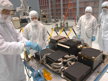 Engineers in Goddard's large clean room prepare the flight spare Science Instrument Control & Data Handling unit, known as SIC&DH 2, for electrical performance testing.