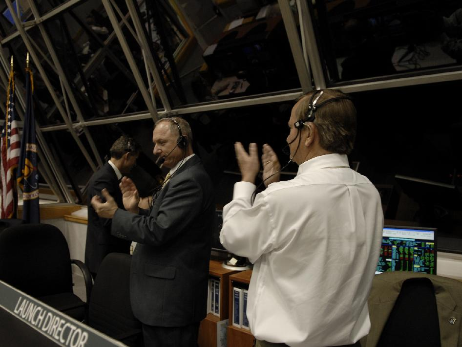 STS-126 launch team celebrates liftoff inside the Launch Control Center.