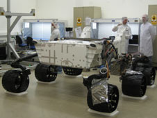 engineers stand with Mars Science Laboratory