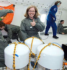 A student smiling inside an aircraft