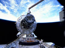 U.S. Unity module suspended over space shuttle Endeavour's cargo bay.
