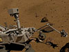 The rover sends a probe to a rock