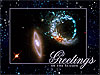 Galaxies with the words Greetings of the Season superimposed
