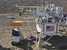 A bucket drum device delivers soil to the Precursor ISRU Lunar Oxygen Testbed