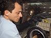 Astronaut working on equipment inside the glovebox