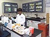Woman wearing lab coat and gloves works in a laboratory