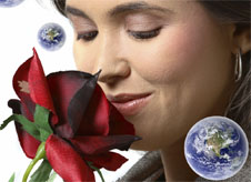 Woman smelling rose, surrounded by floating Earth images.