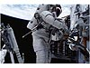 A spacewalker works on the Hubble Space Telescope