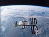 The International Space Station against the backdrop of Earth's horizon and blackness of space