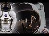 A futuristic spacesuit inset beside an astronaut's helmet visor