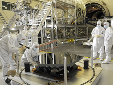 Engineers inspecting a JWST mirror