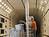 Engineer Tom Ivanco inspects the Ares I-X scale model launch tower between tests in Langley's Transonic Dynamics Tunnel