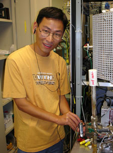 Postdoc Zongping Shao listens to a fuel-cell powered MP3 player.